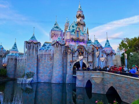 Sleeping Beauty castle decorated with sparkling holiday wreaths