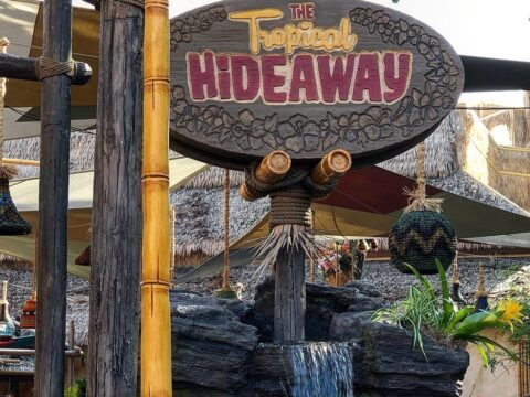 The Tropical Hideaway wooden sign with waterfall