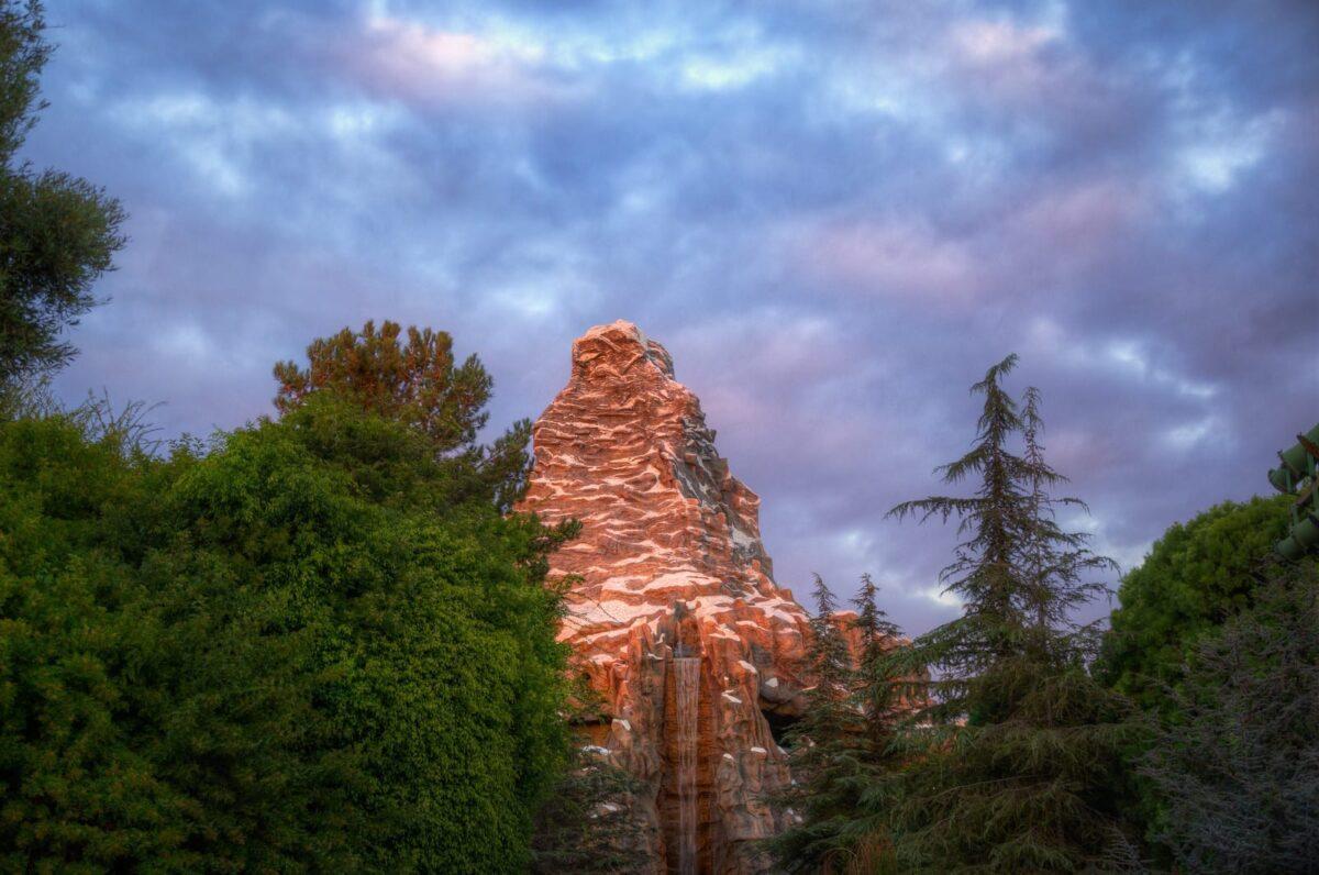 Cloudy Sunset Over Matterhorn Mountain and Tall Green Trees