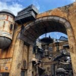 Rusted Brick Arch with Star Wars Themed Decor Inside Galaxy's Edge