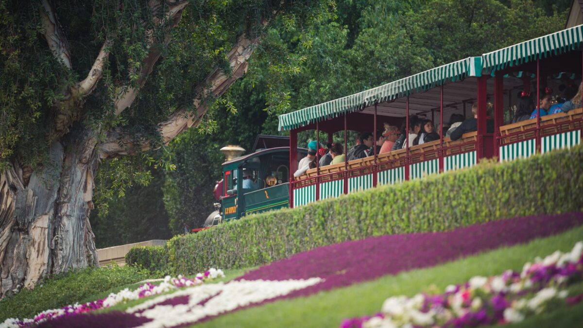 Green and White Striped Train Filled with Guests