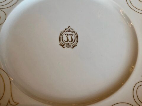 """White Ceramic Plate with Gold Detail and """"33"""" in Center of Plate"""