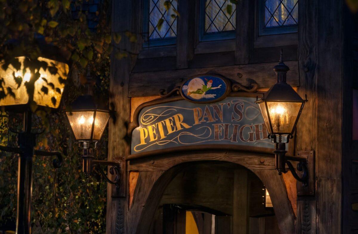 Peter Pan's Flight Entrance, Dim Lighting with Brown Sign