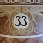 "Light and Dark Brown Wooden Floor with Black ""33"" In Center"