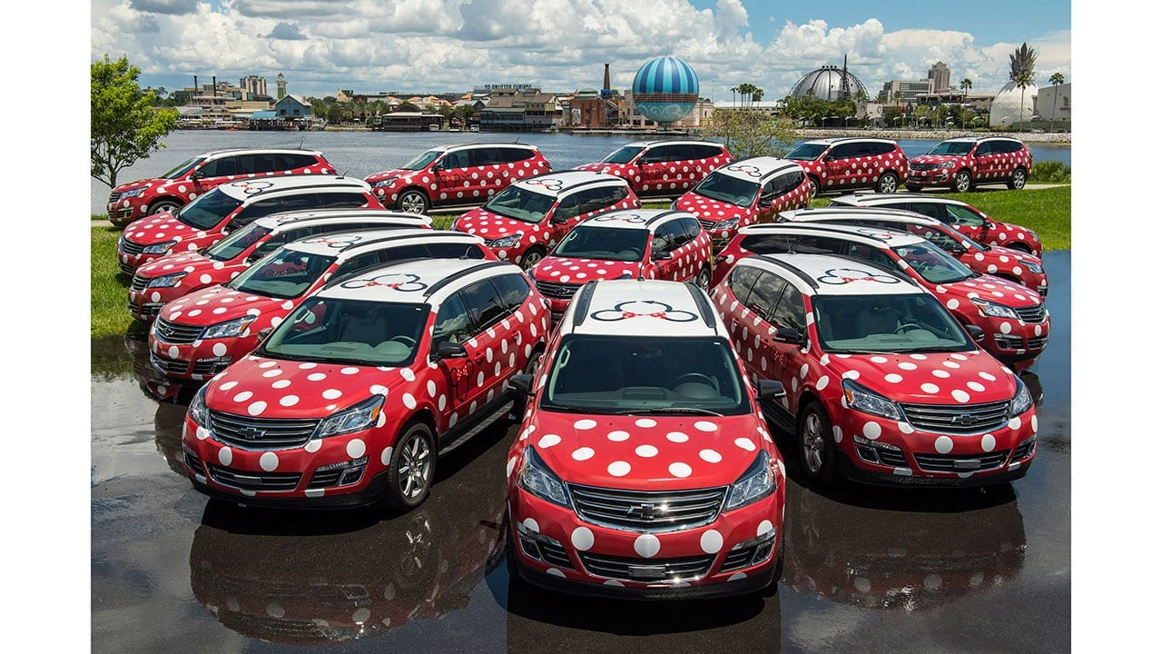 Parking lot of red and white Minnie Mouse Vans