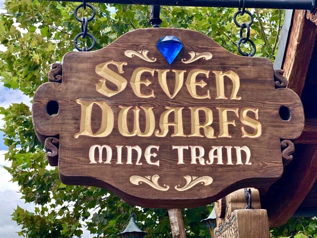 Seven Dwarfs Mine Train attraction sign