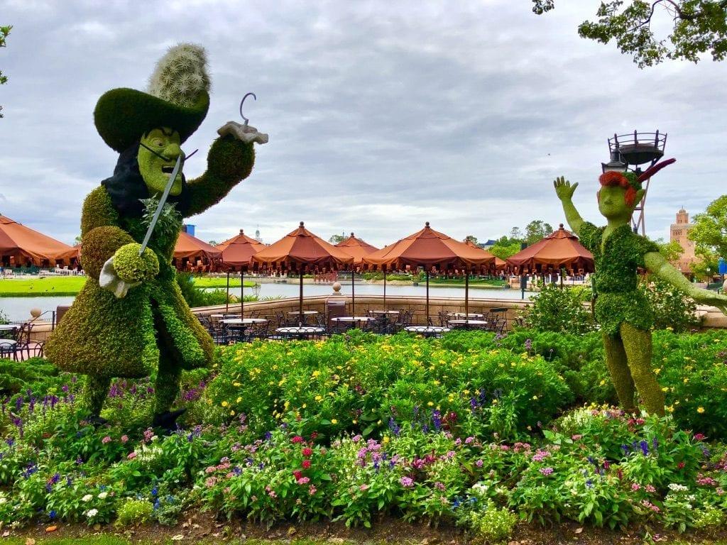 Peter Pan and Captain Hook green sculptures at garden festival