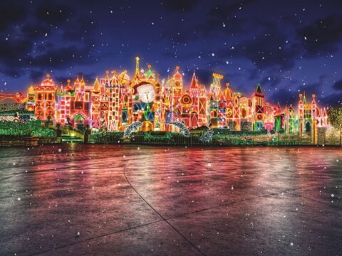 It's a Small World attraction decorated in Christmas lights with snow falling