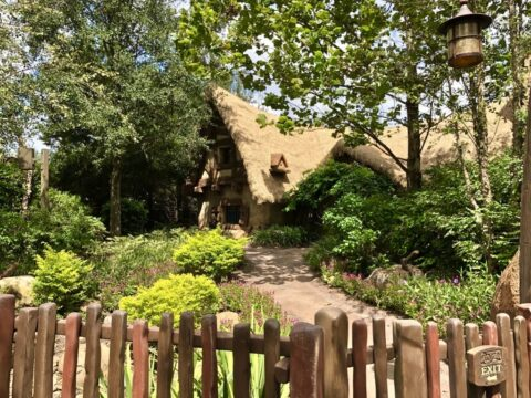 Seven Dwarfs Mine Train Attraction, brown cottage with greenery