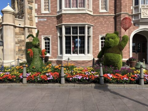 Winnie the Pooh and Rabbit sculptures outside of brick building