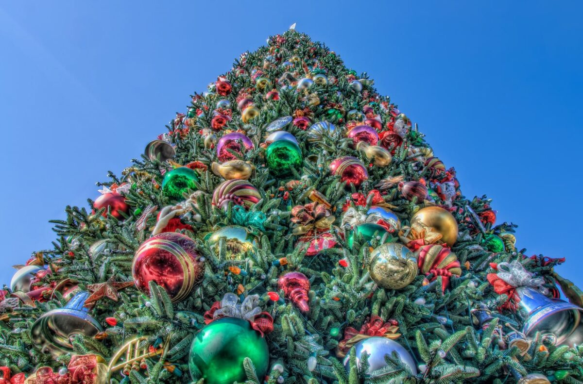 Large green Christmas Tree decorated with green, red, and gold ornaments