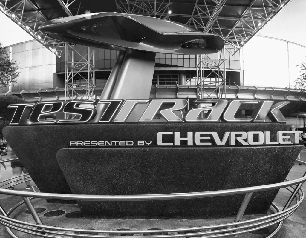 Test Track attraction entrance black and white photo