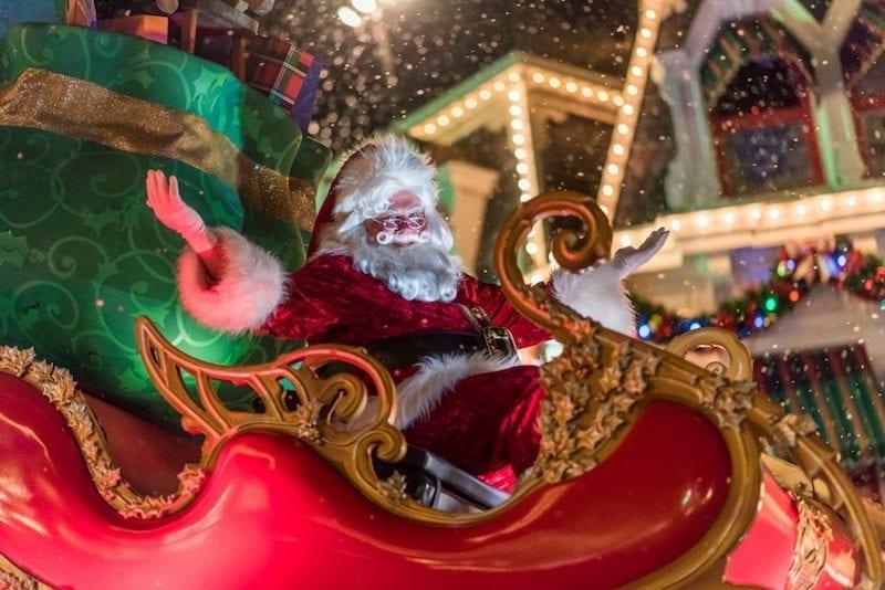 Santa on sleigh parade float at Christmas parade