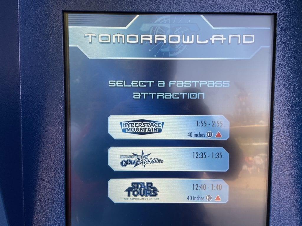 Tomorrowland fastpass attraction sign