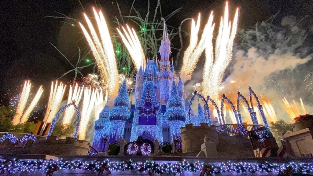 Cinderella's Castle during Mickey's Very Merry Christmas Party with Fireworks and Christmas lights