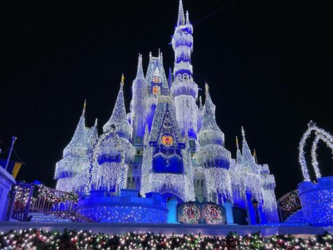 Cinderella's Castle decorated with Mickey's Very Merry Christmas Party