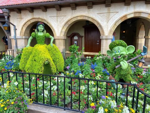Snow White and Dopey moss sculptures at EPCOT