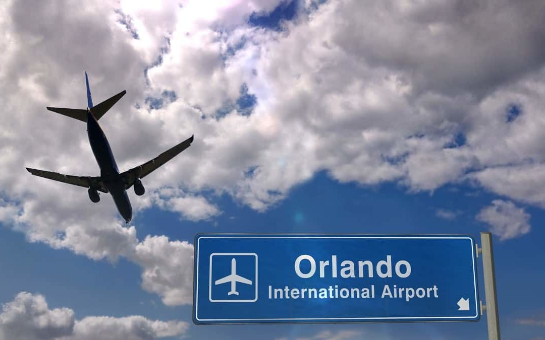 Airplane flying over Orlando International Airport sign