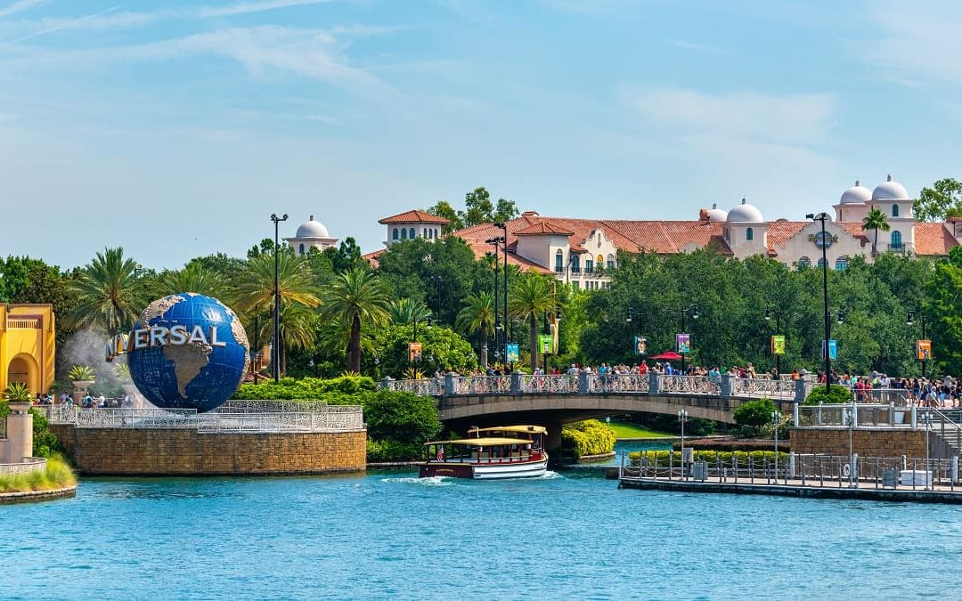 Universal Orlando Boardwalk exterior view with Universal globe and river