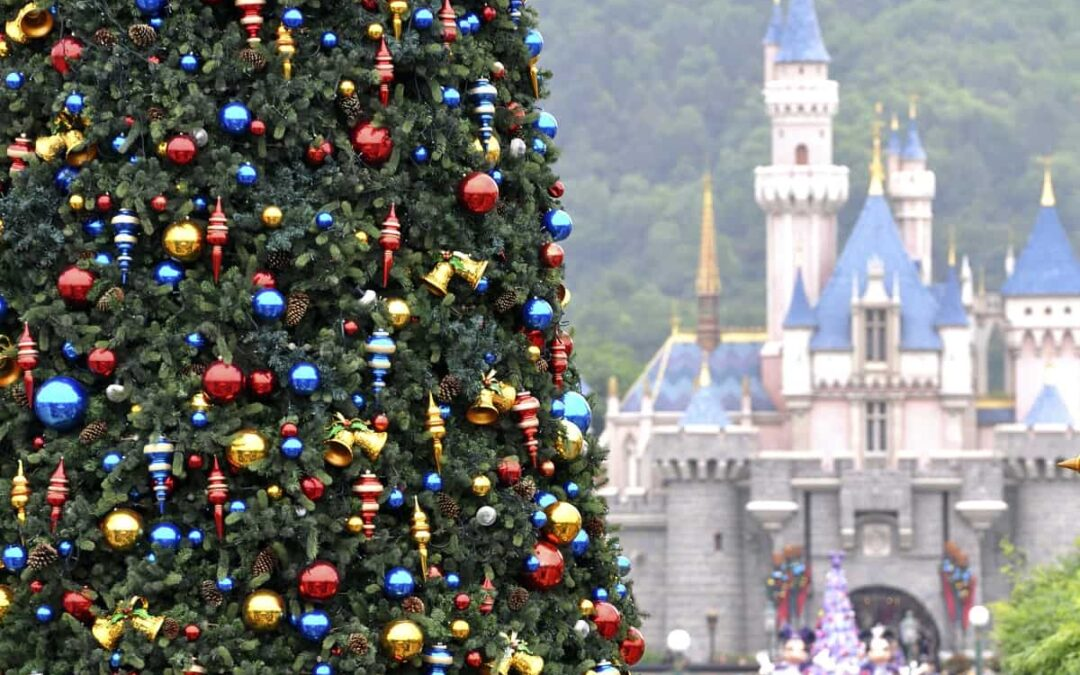 christmas tree with ornaments and Disney castle in background