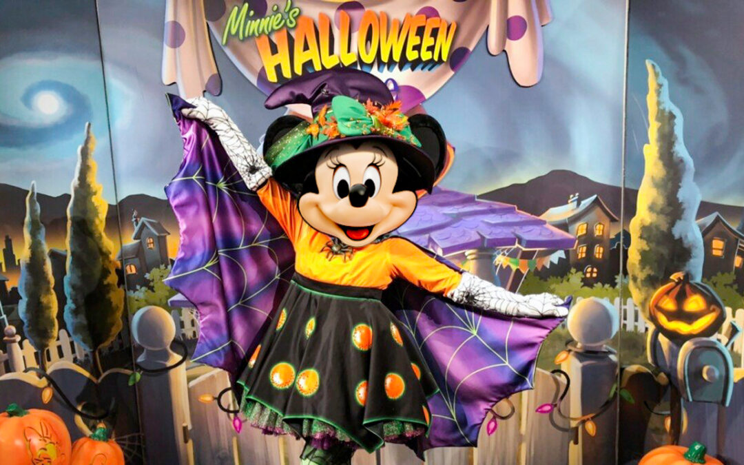 Minnie Mouse dressed in a spider halloween costume