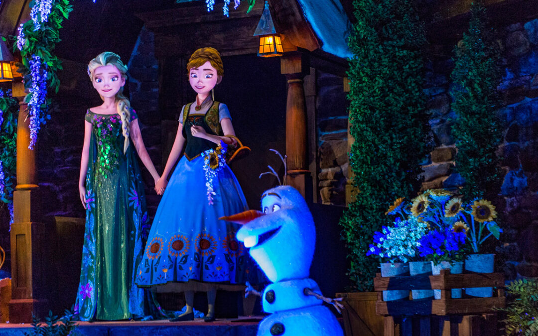 Anna, Elsa and Olaf Frozen Characters on a porch at night