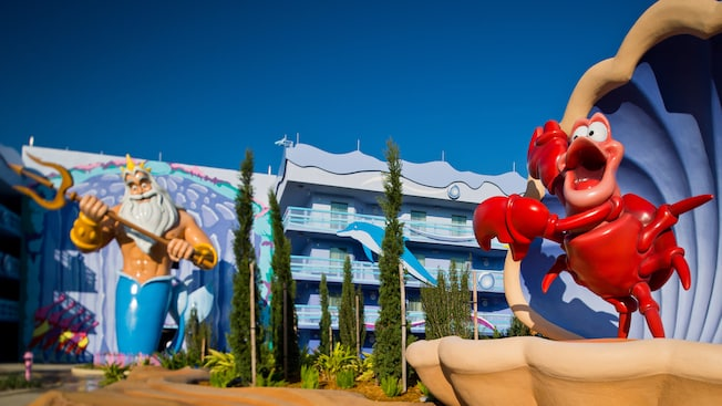 Sebastian and King statues outside Little Mermaid building