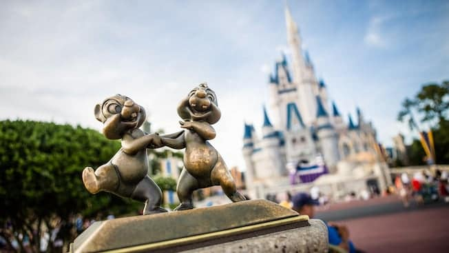 Close up of Chip and Dale Statue with castle in background