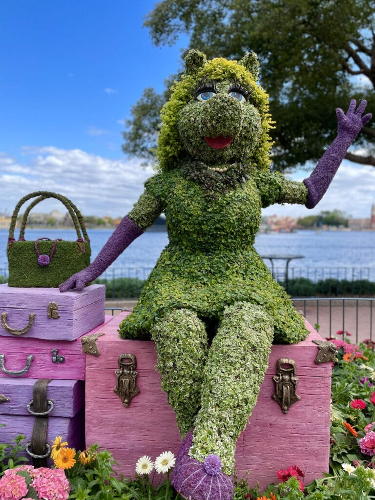 Ms. Piggy topiary with luggage