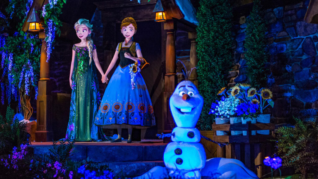 Elsa, Anna and Olaf in a village