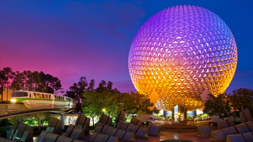 Spaceship Earth Ball at night with monorail train