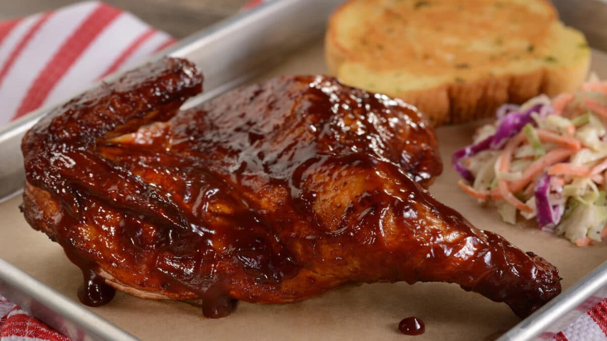 BBQ chicken leg with coleslaw and toast