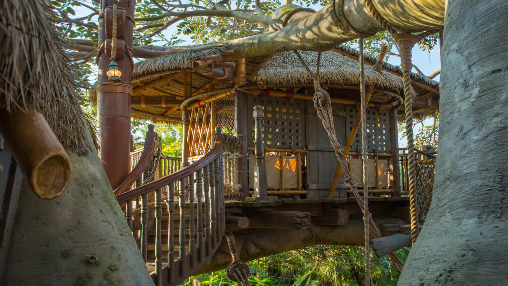 A treehouse with rope bridge