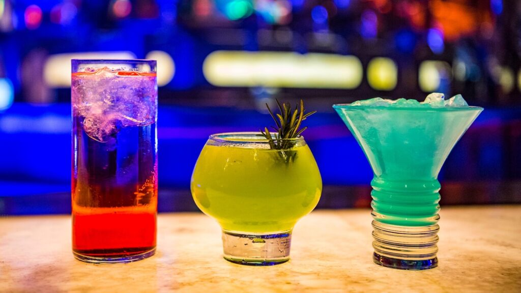 Colorful drinks at a space bar