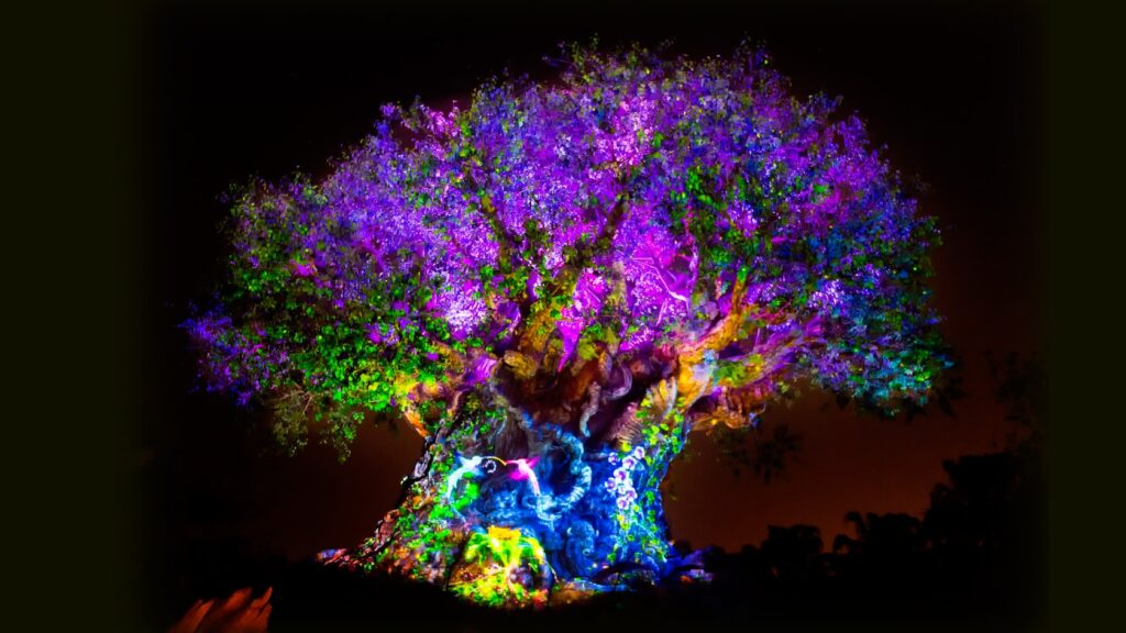 Tree of Life with color projections at night