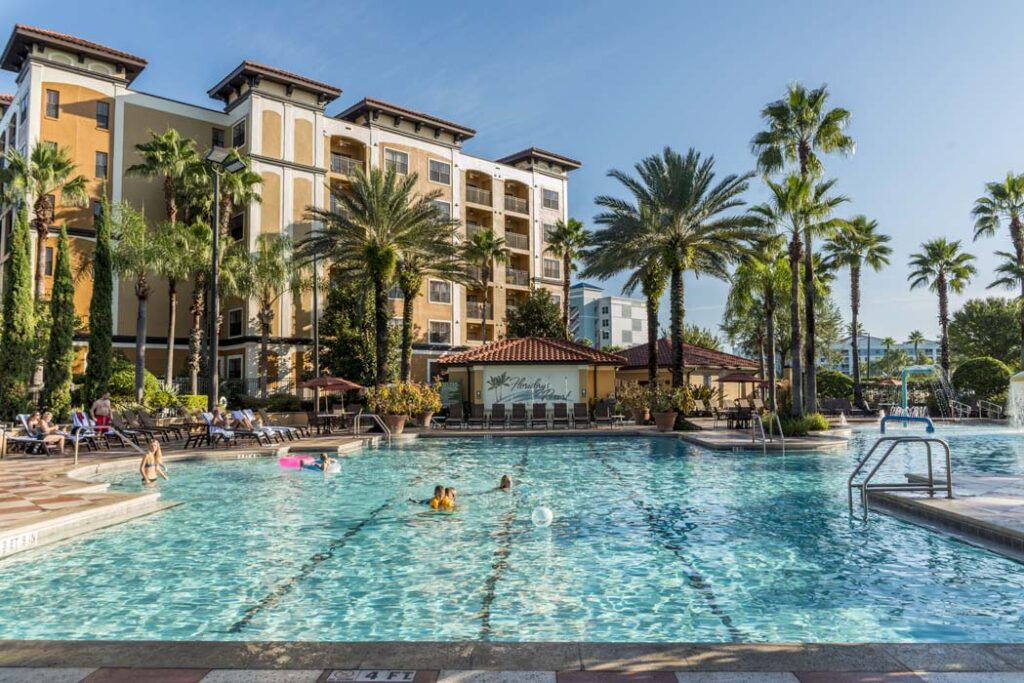 Hotel pool with palm trees