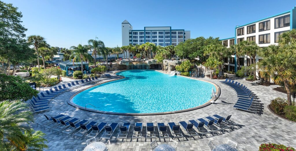 Large hotel pool with chairs