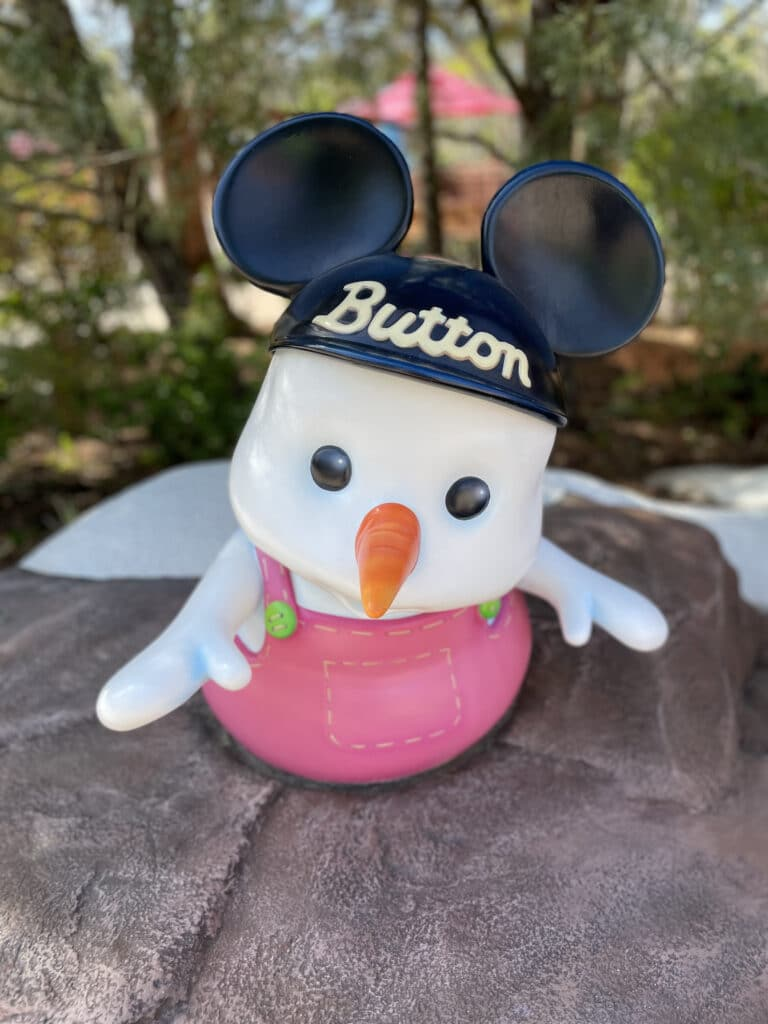 Tiny snow girl with Mickey ears