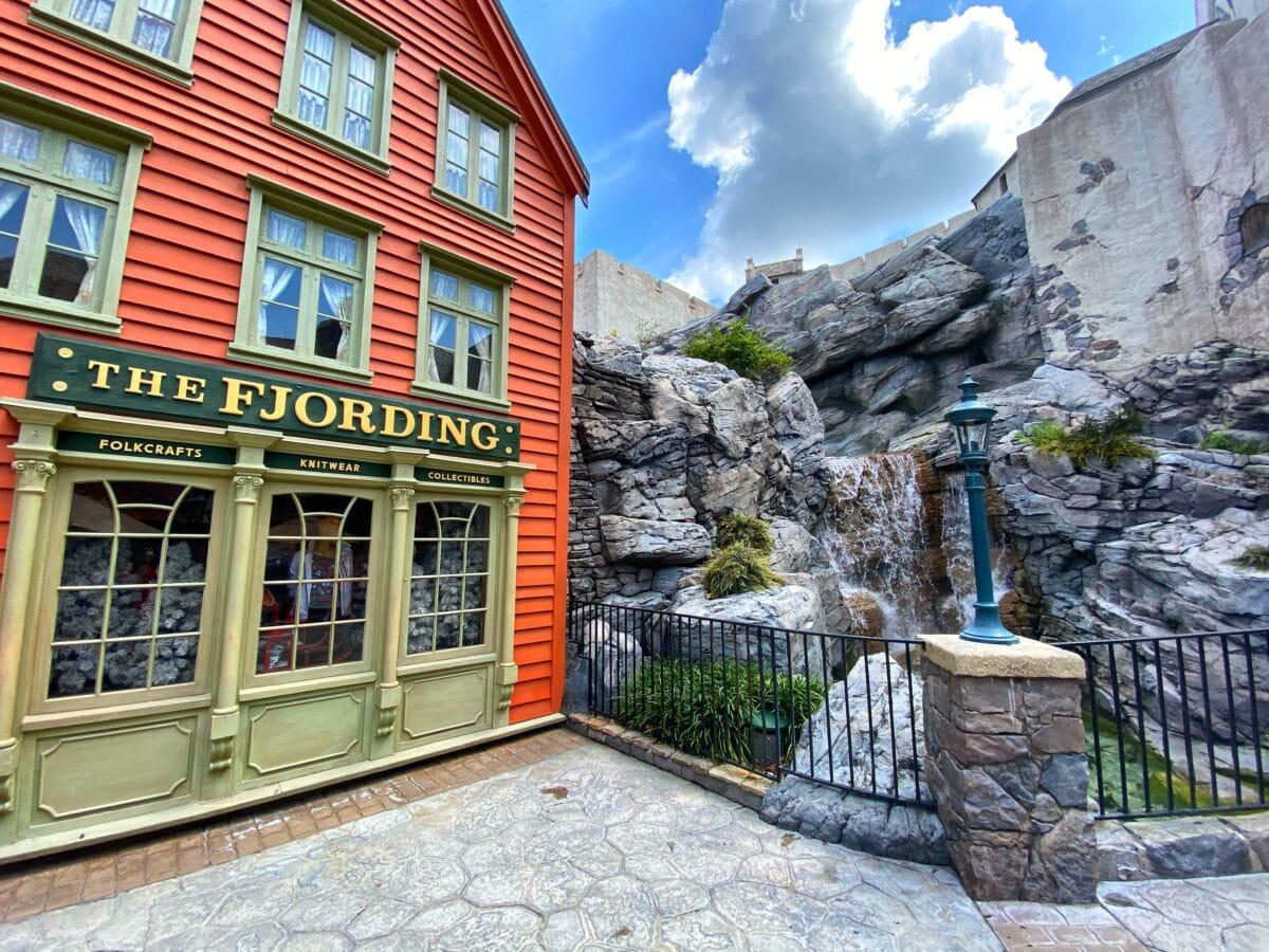 Norwegian building and waterfall