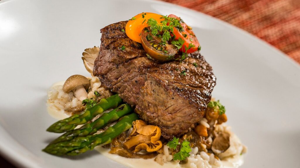 Steak topped with vegetables