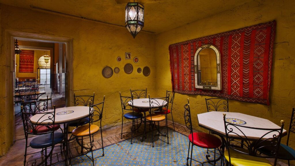 Three tables inside Moroccan cafe