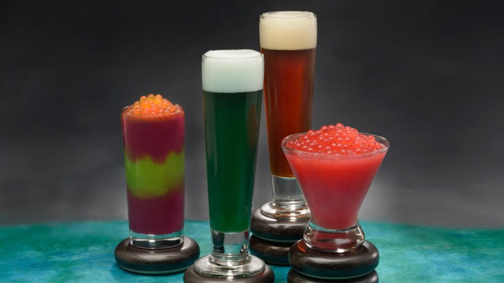Four colorful frozen drinks in cups