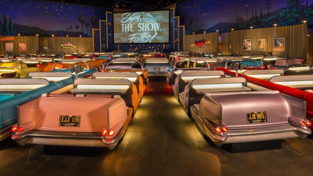 Old cars at an indoor theater