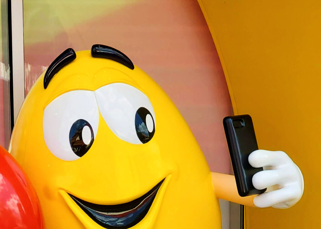 Yellow M&M taking selfie