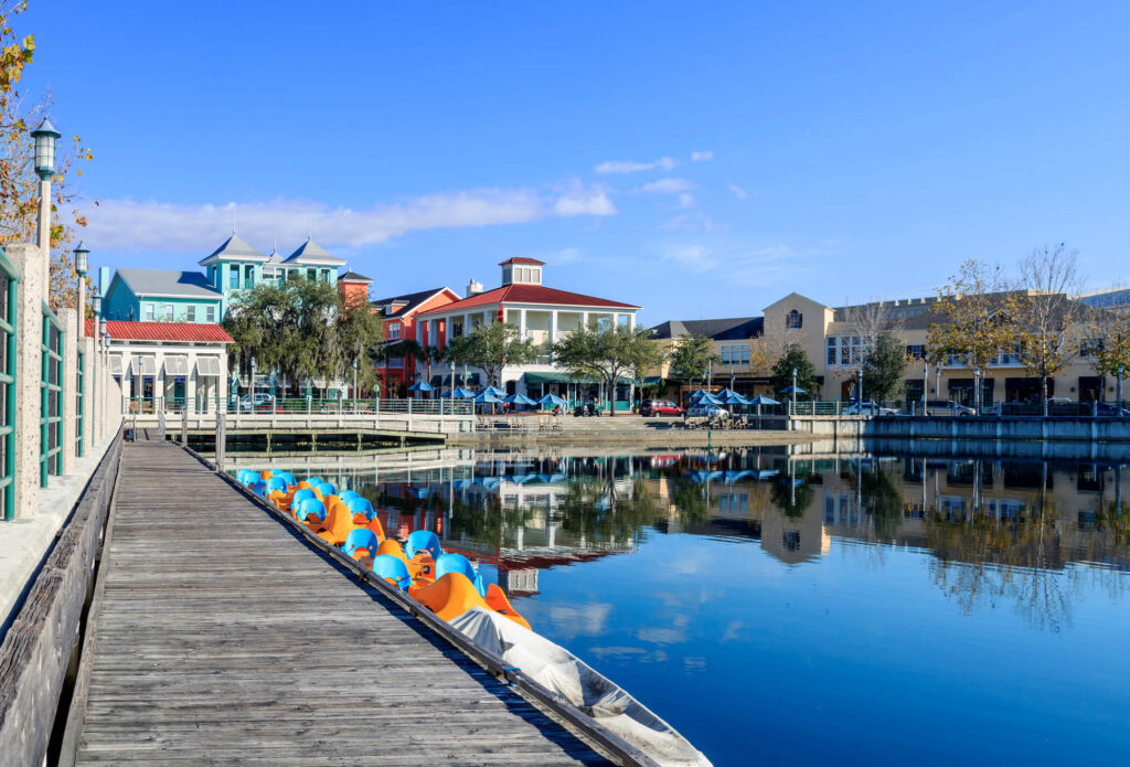 City with dock, boats and shops