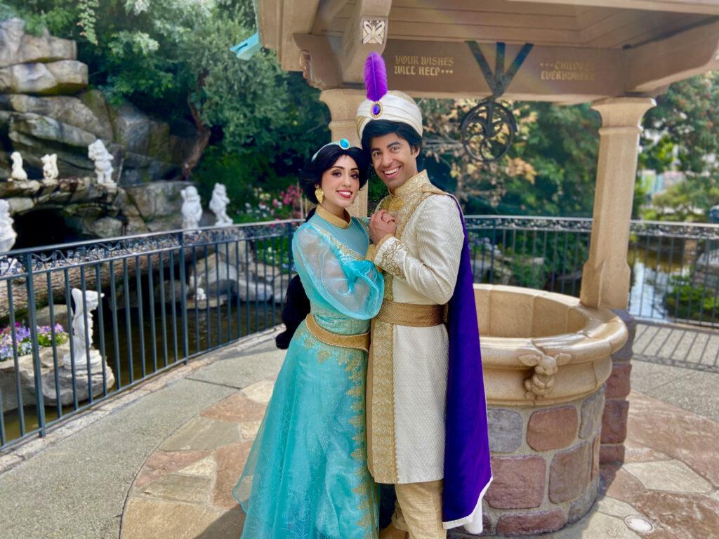 Jasmine and Aladdin holding hands