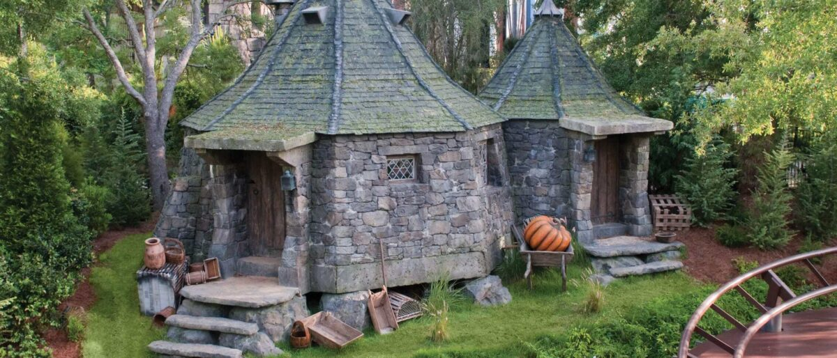 Two stone huts with pumpkins
