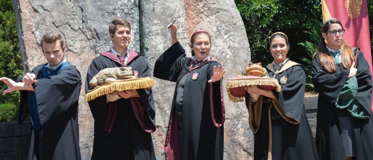 Wizarding student choir with frogs