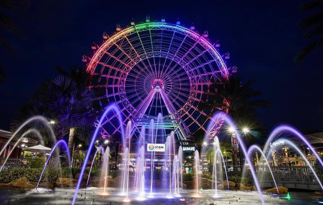 Colorful ferris wheel at night