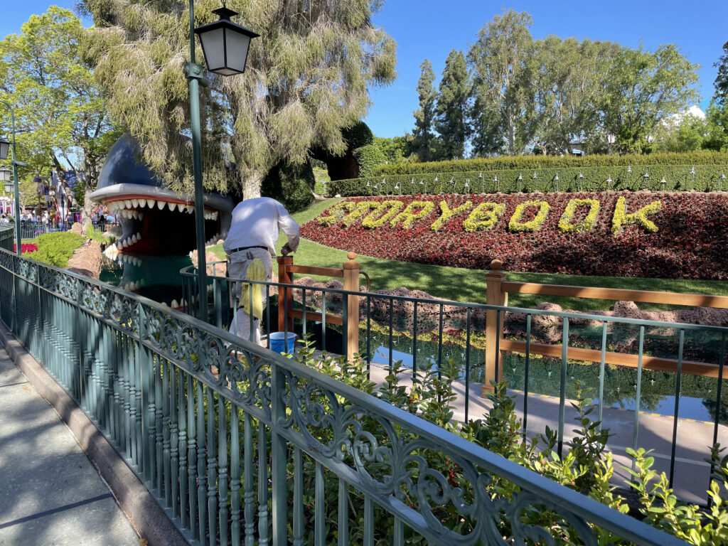 Man painting handrail at attraction